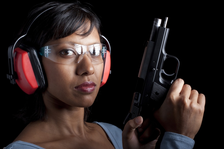 bigstock-Woman-at-gun-range-21736562.jpg